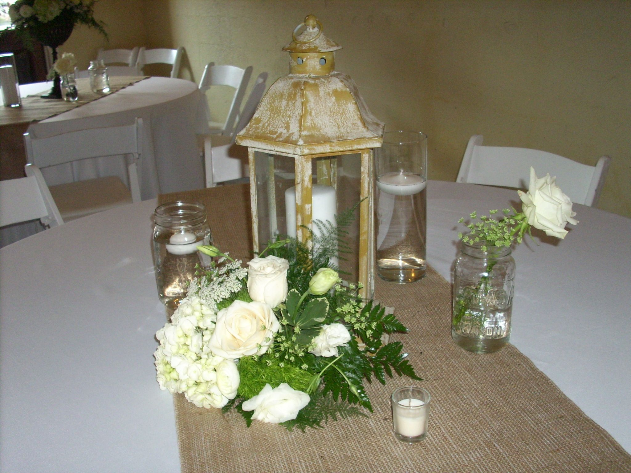 Wedding gate decoration ideas  Lantern Centerpiece Weddings Pinterest  Wedding Centerpieces