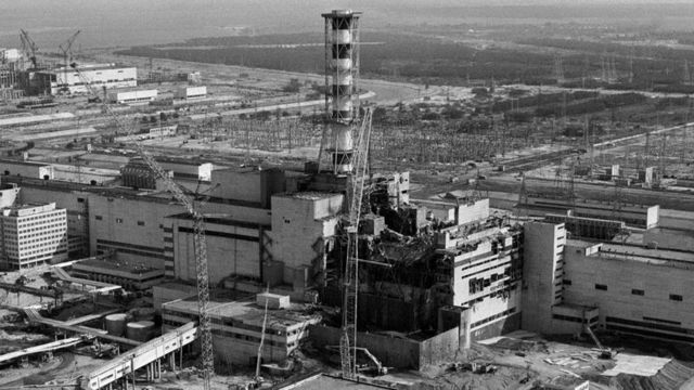 (FILES)- Picture taken from a helicopter in April 1986 shows a general view of the destroyed 4th power block of Chernobyl's nuclear power plant few days after the catastrophe. A reactor at Chernobyl blew up on April 26, 1986 in the worst nuclear accident in history. It burned for some 10 days, sending radiation across a large swathe of Ukraine, Russia and Belarus. A World Health Organisation report released in September put the overall death toll from Chernobyl at 4,000, though the figure…