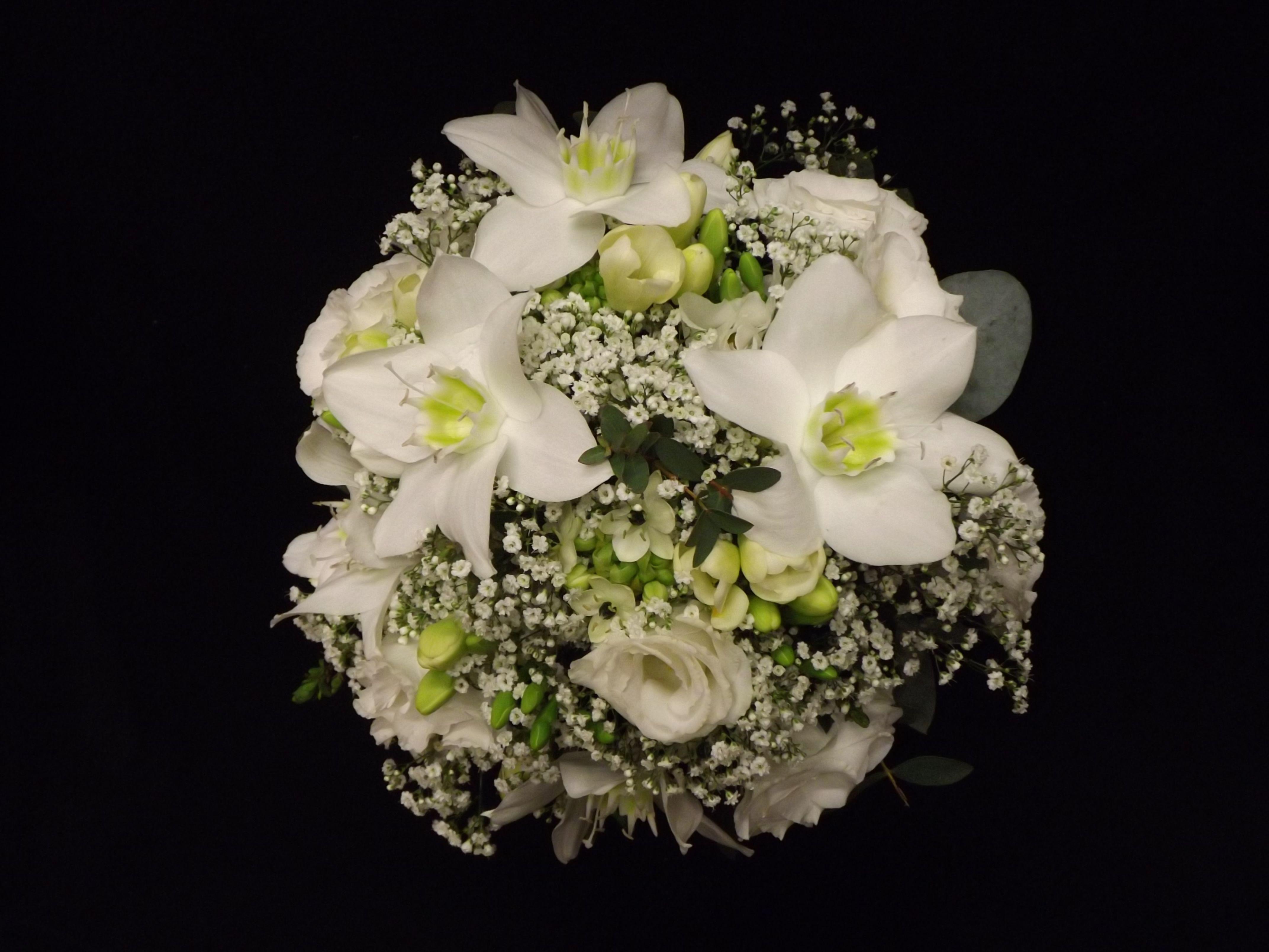 Bridesmaids hand tied of eucharis, lisianthus, freesia and gyp  www.weddingflowersbylaura.com