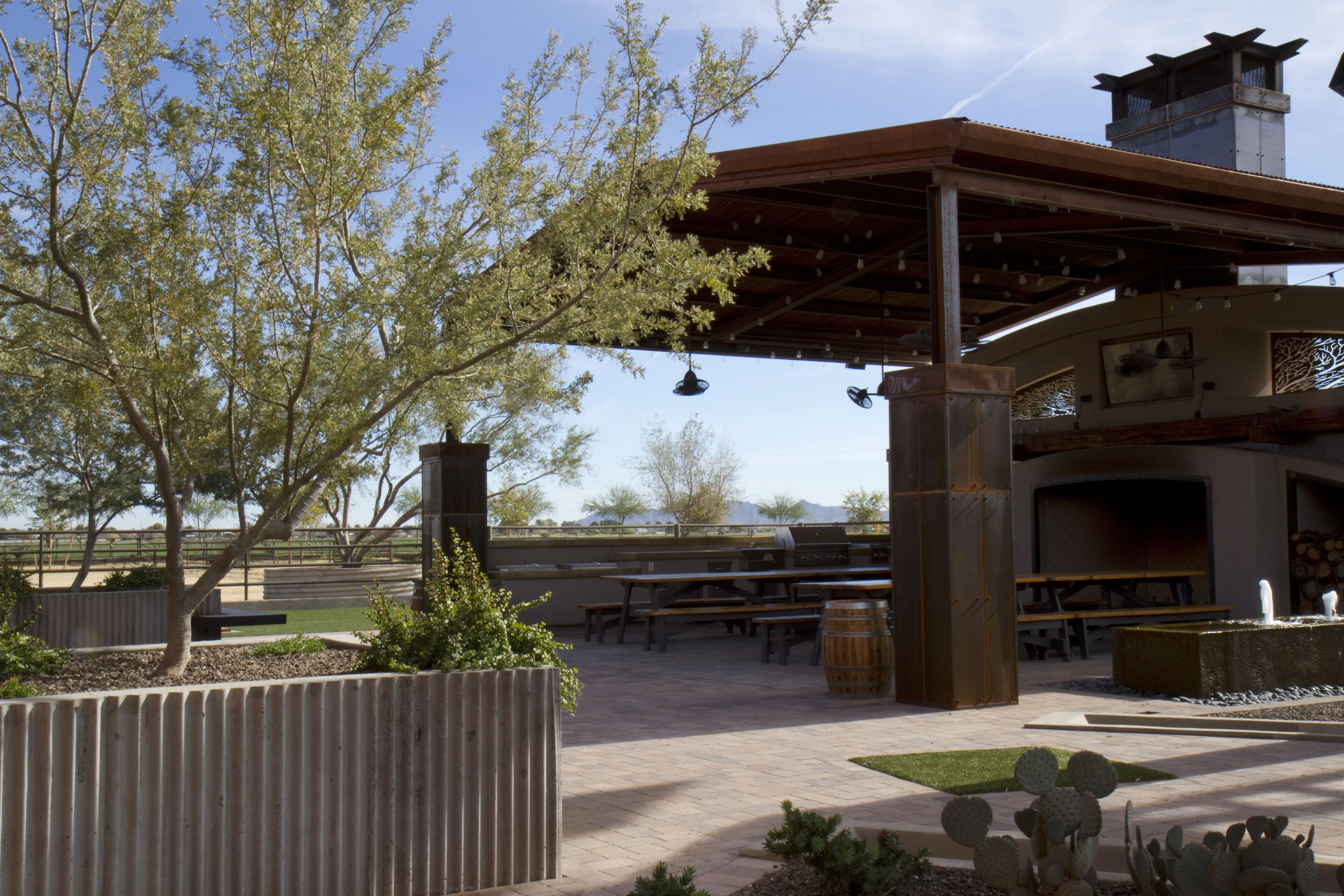 Steel incorporated into an outdoor space for
