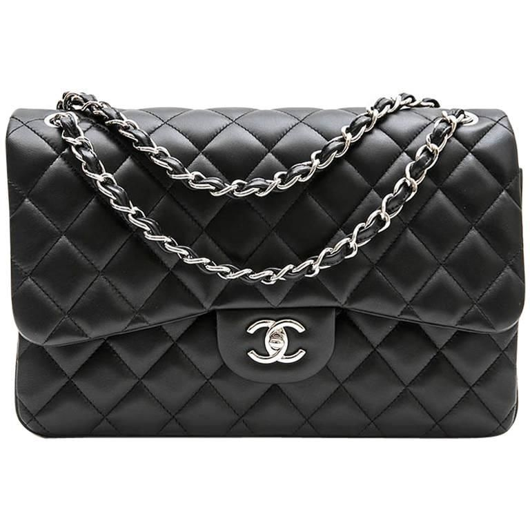 4700f6beb821 For Sale on 1stdibs - Chanel 'Jumbo' bag in black smooth lamb leather.  Double flap. Silver metal hardware. Made in Italy. Private Sales 2017.