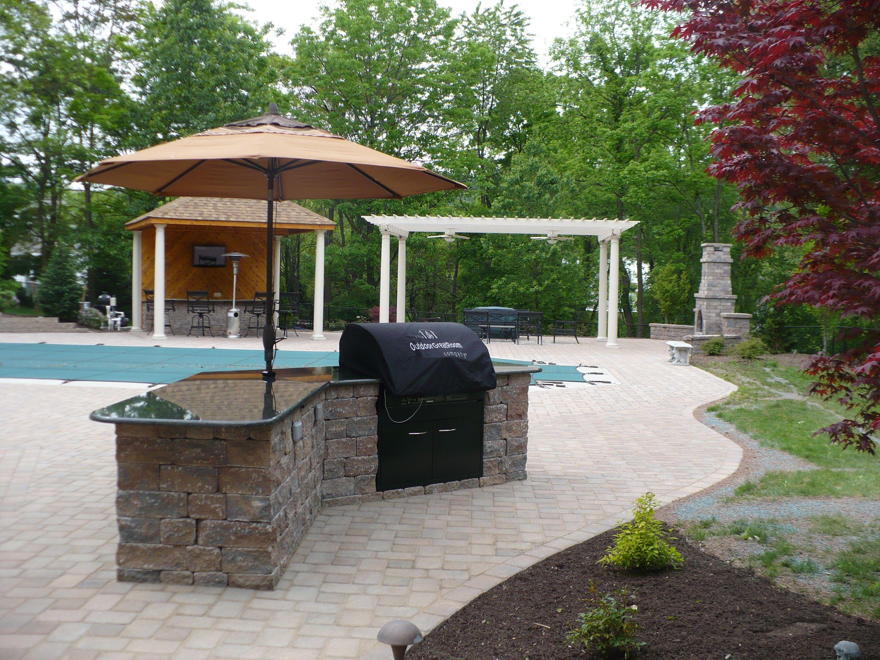 Grill Island, Outdoor Kitchen, Patio, Pergola, Pool Surround, Plantings.