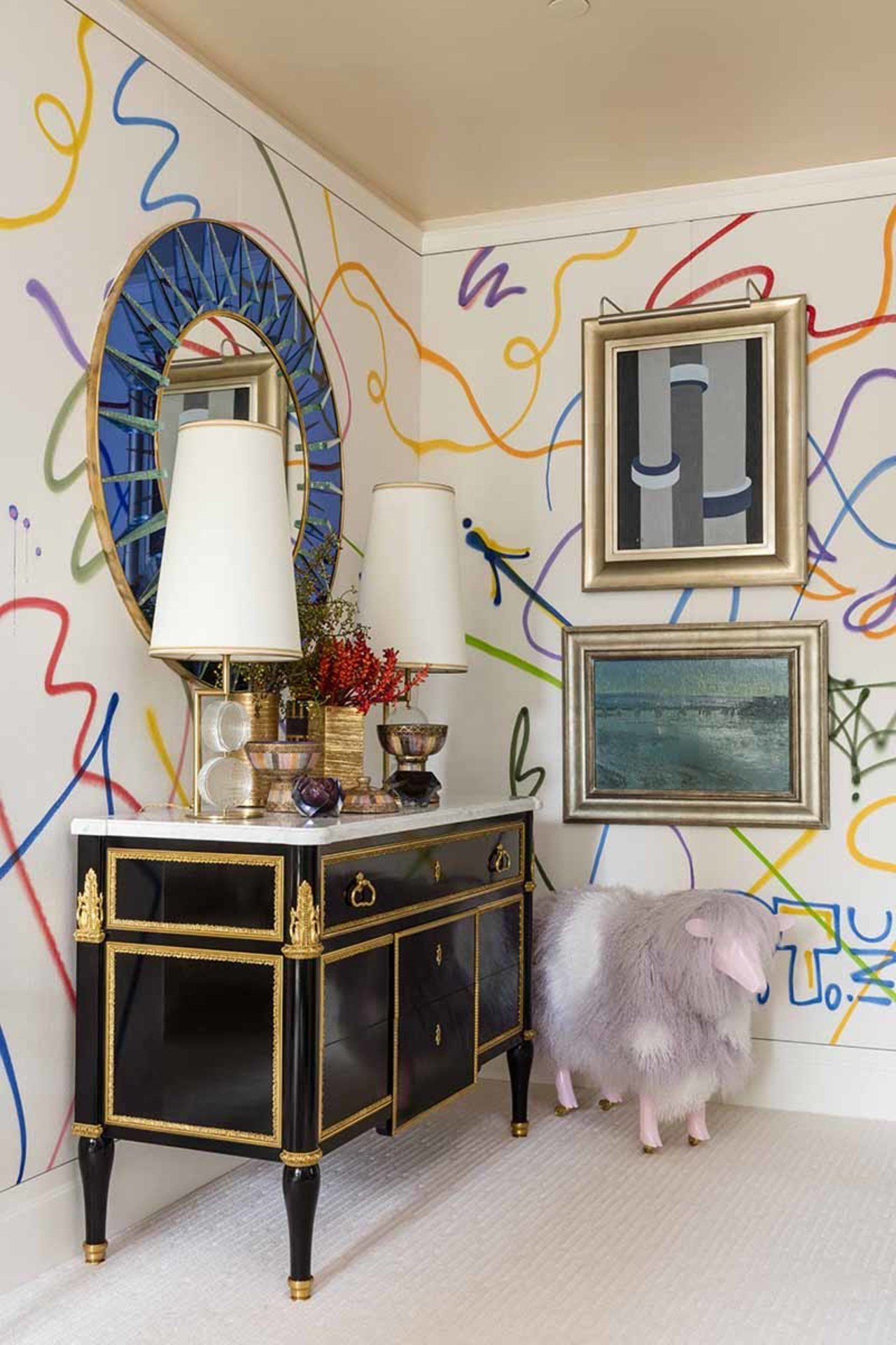 Graffiti Covered Walls Create A Whimsical Backdrop For Antique Curio And Art In This Room Designed Bold Paint Colors Antiques Minimalism Interior