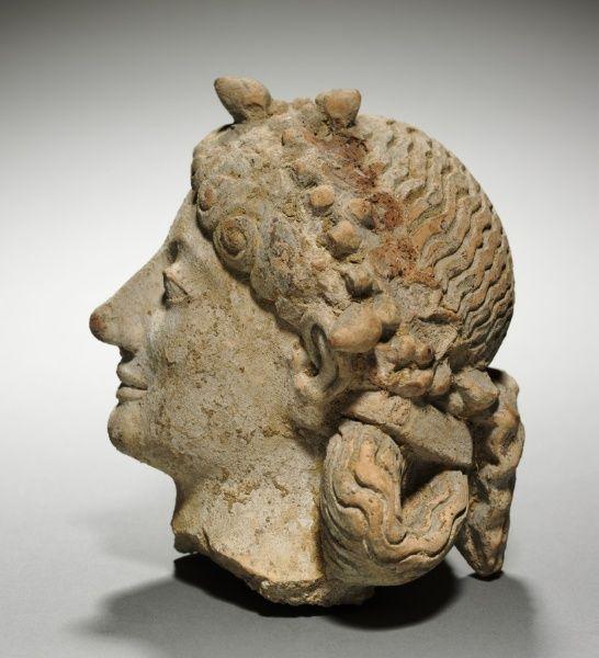 Head of  Greek: Artemis/ Roman: Diana, 600-575 BC Greece, late 6th Century BC  terracotta