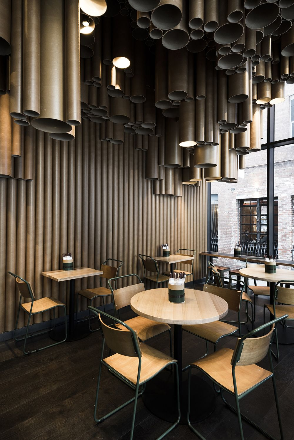 techné makes creative use of cardboard tubes at grill'd's new