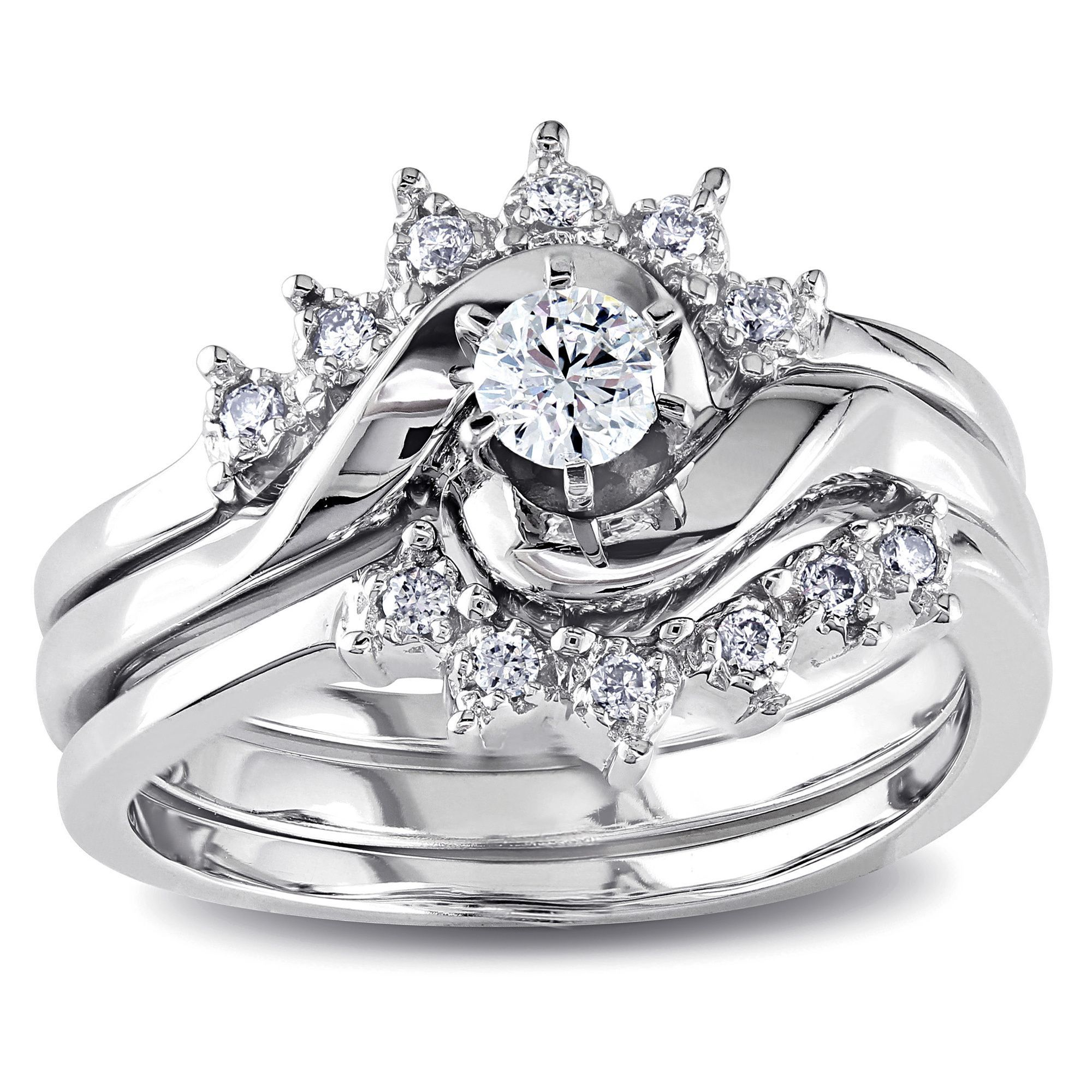 The brilliant 16carat roundcut center diamond is prong set into a