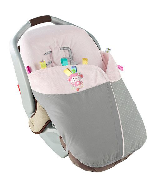 Lined with satin tags, this blanket provides tactile comfort while on the go. Its unique design can attach to almost any car seat, gently wrapping Baby in soft, soothing boa lining. An easy front zipper closure provides quick and easy access, while the outer shell is water-resistant and machine washable.
