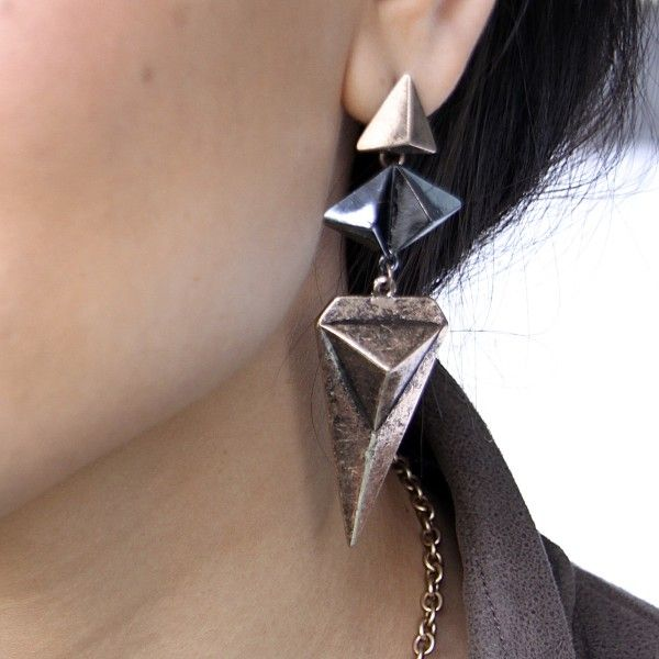 Black and brass multi triangle dangle earrings with triangle detail. #jewelry #fashion #style