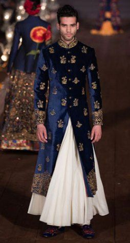 4c987abb56 Blue Velvet and gold bandhgala sherwani with a white flare lower for the  Indian Groom | Rohit Bal | Curated by Witty Vows