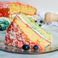 Red, White, and Blue Zinger Cake | This patriotic cake is the BEST 4th of July dessert recipe, Memorial Day dessert recipe, or Labor Day dessert recipe. This easy Red, White, and Blue Zinger cake is covered in shredded coconut and filled with a marshmallow cream to make a beautiful red, white, and blue dessert for the 4th of July! #labordaydesserts Red, White, and Blue Zinger Cake | This patriotic cake is the BEST 4th of July dessert recipe, Memorial Day dessert recipe, or Labor Day dessert reci #labordaydesserts