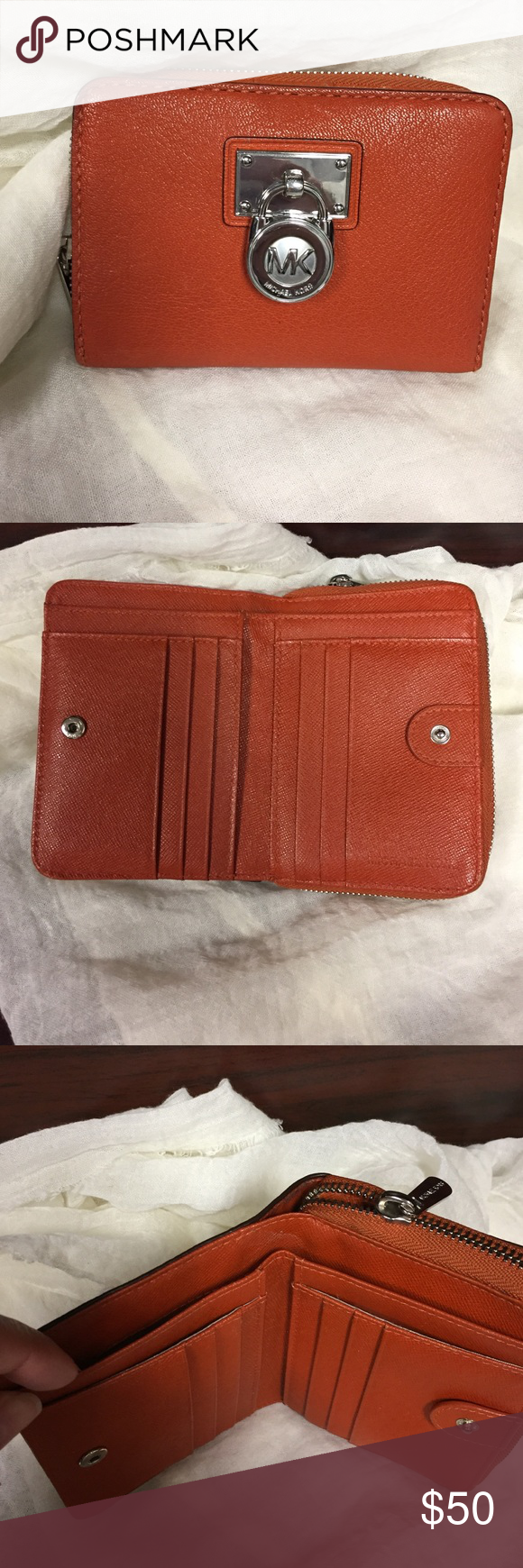 ✨Like New Michael Kors Wallet ✨ I just purchased this beautiful item on Posh a week ago but the buckle is too big for my tiny purse. My loss is your gain! This wallet is a genuine beauty. The color is unique.PLEASE DO NOT LOWBALL THIS ITEM!! KORS Michael Kors Bags Wallets