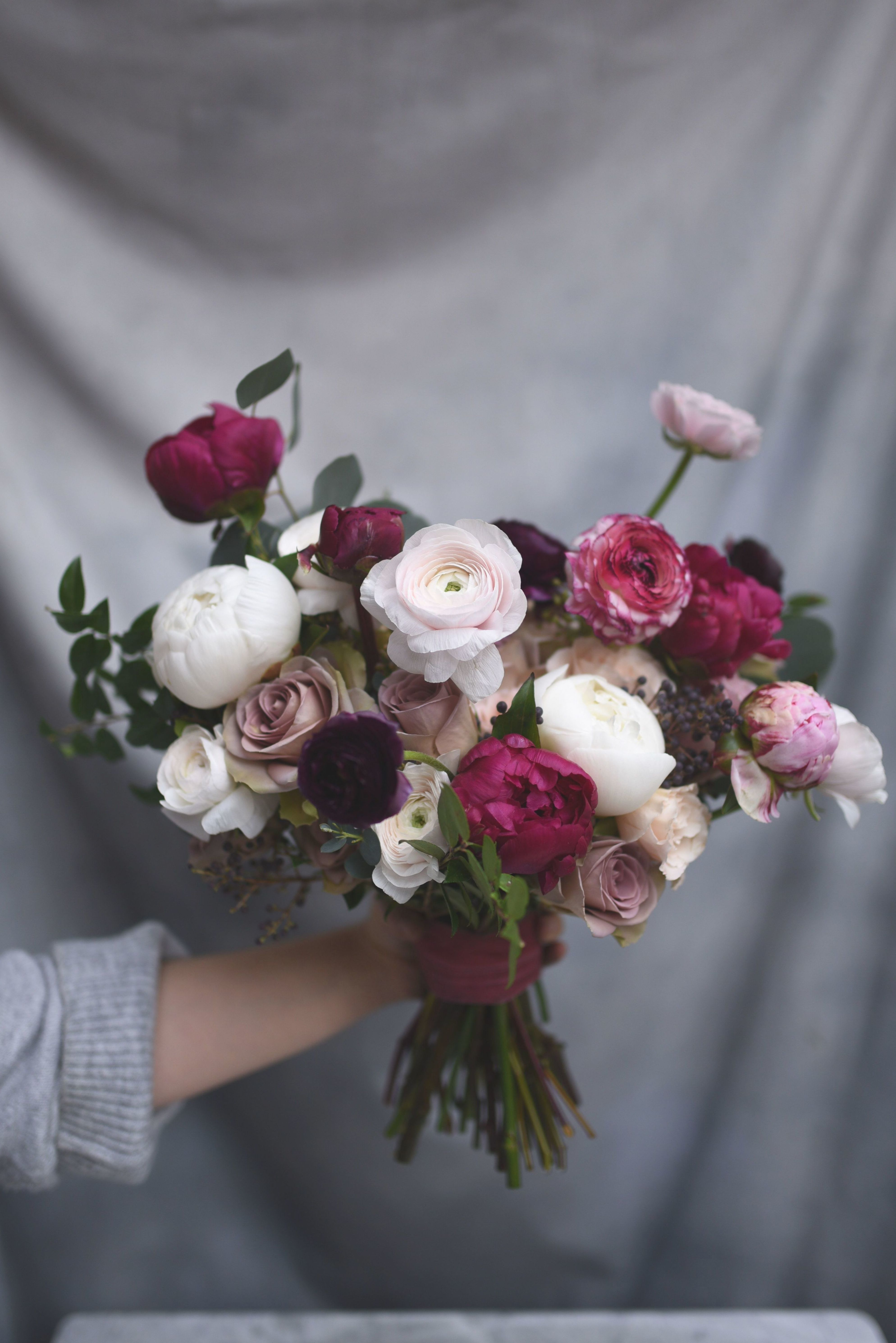 Bridal Bouquet Featuring Pale And Burgundy Peonies Ranunculus And Amnesia Roses With Green In 2020 Ranunculus Wedding Bouquet Ranunculus Wedding Peony Bouquet Wedding