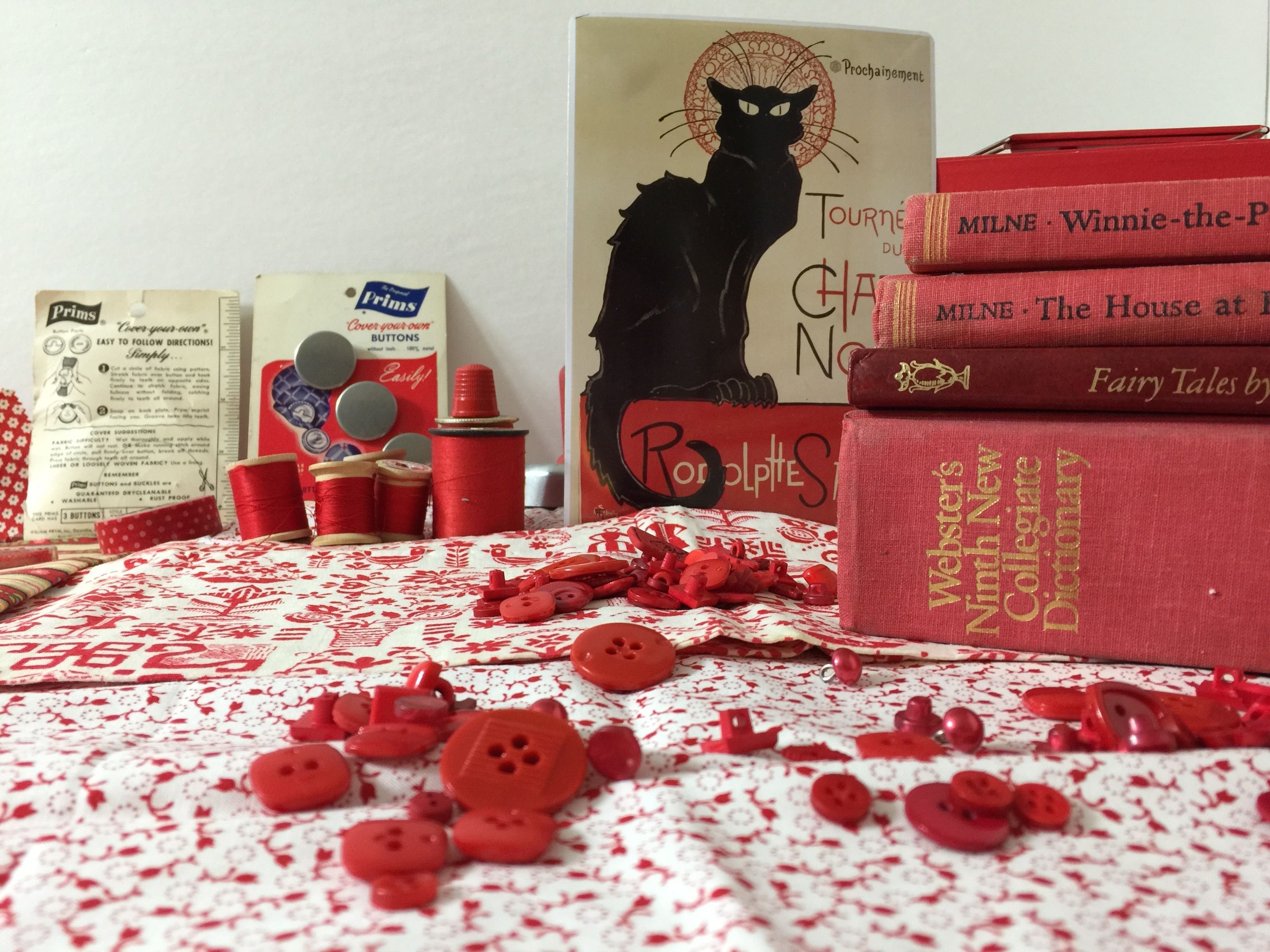 a meditation of the color red; craft supplies vintage fabric thread books beads buttons Le Chat Noir