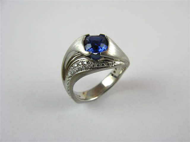 Blue Sapphire Cushion 1.48ct. 14kt. white gold. Dia. twt. 0.30ct.