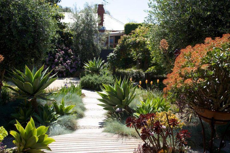 backyard patio sidewalk slab with modular raised garden bed also