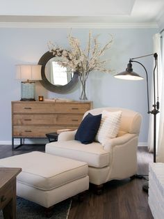 Blue Walls Black Accents Could Be White Accents With Black Blue Lamp Hgtv S Fixer Upper With Chip Farm House Living Room Home Living Room Flooring