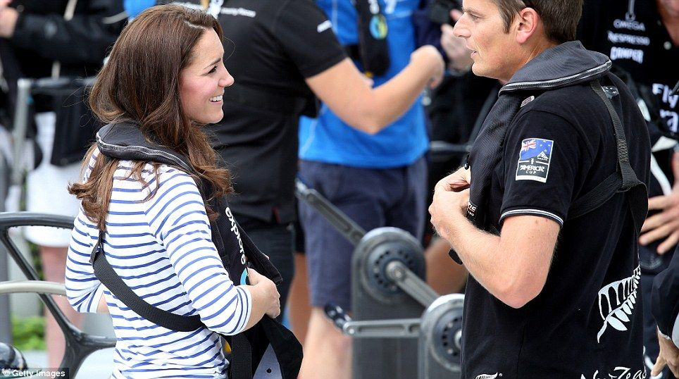 Safety first: The Duchess ensured her life jacket were strapped on tight before the race
