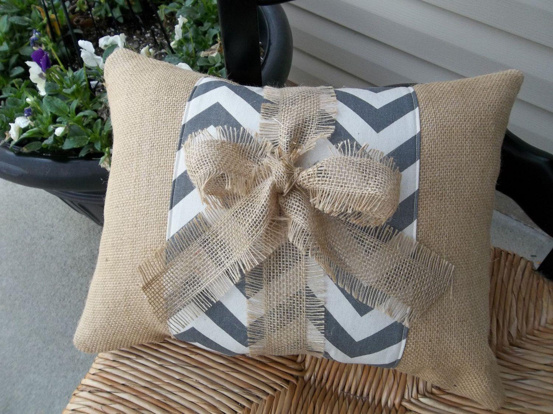 Grey chevron band on natural burlap pillow with burlap tie