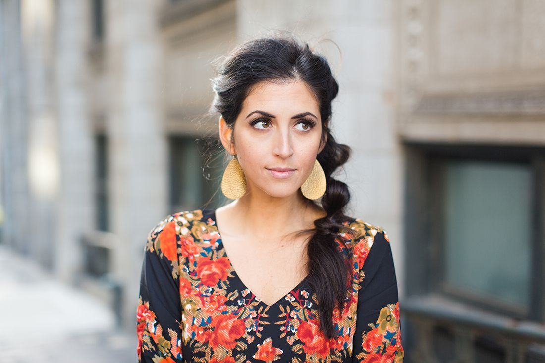 Gorgeous gold leather earrings, natural make-up, floral dress, and messy braid. This look is perfect for the holidays.