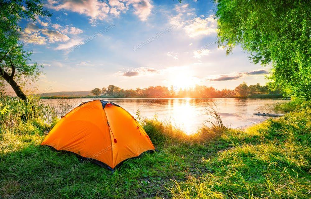 Orange tent on the lake at sunset By Alexlukins photos