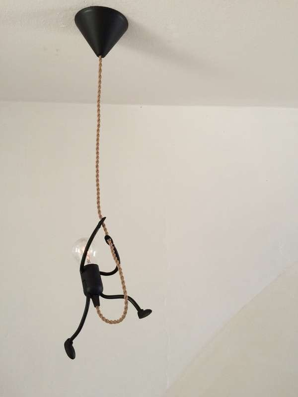DIY Funny Stick Figure Hanging Light: great fir any kids room, industrial  decor or someone with a sense of humor. Super cute!!