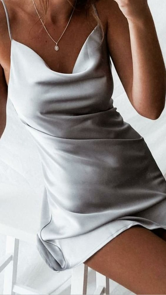 We have a cream white silk satin short bias slip dress almost as the one seen on...