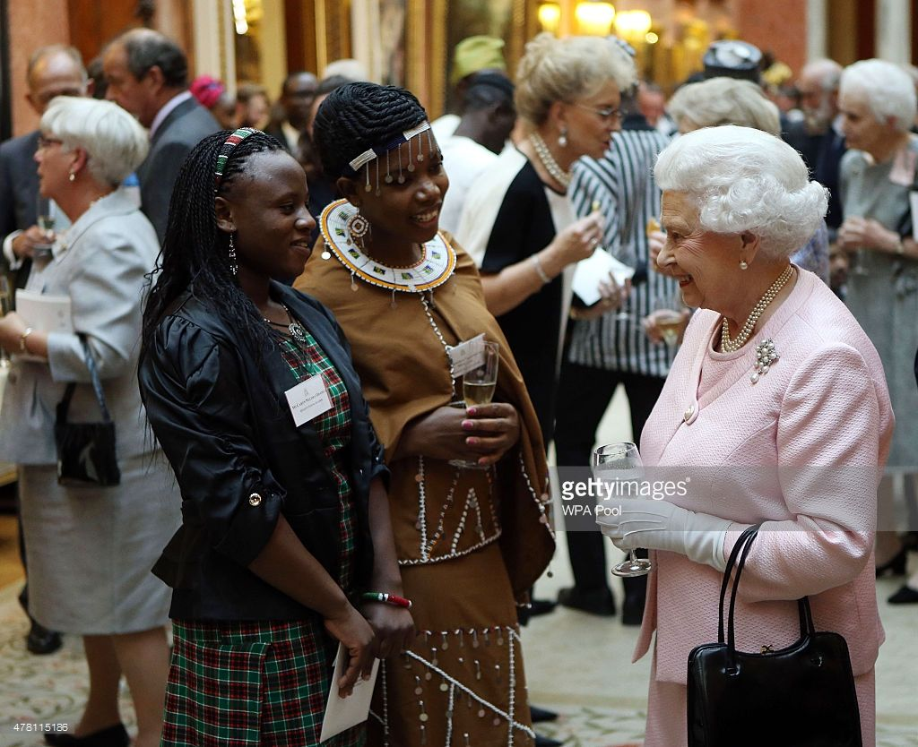 Queen Elizabeth II talks to guests at a reception at Buckingham Palace to…