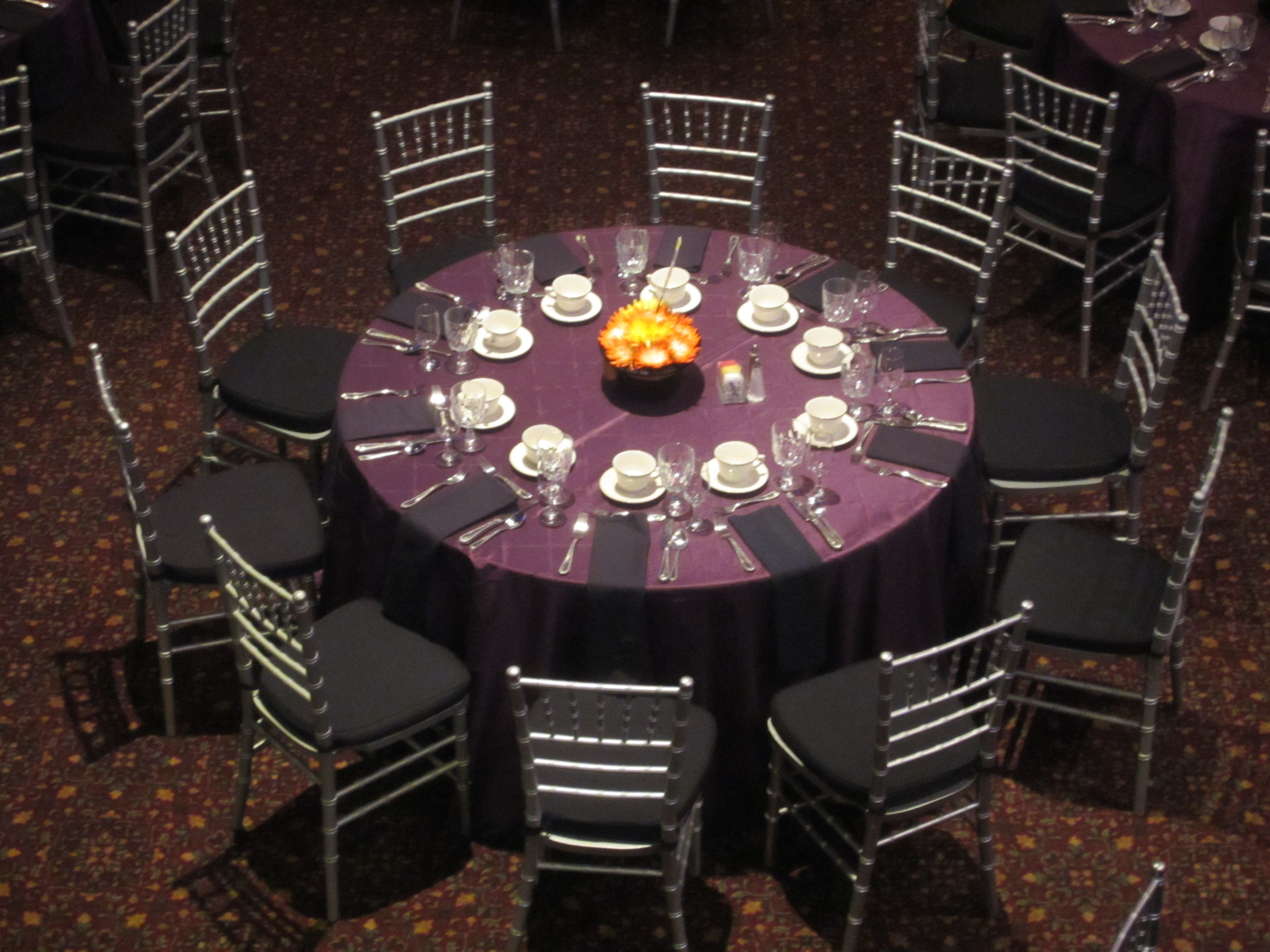 Pretty room layout with purple pintuck tablecloths and silver