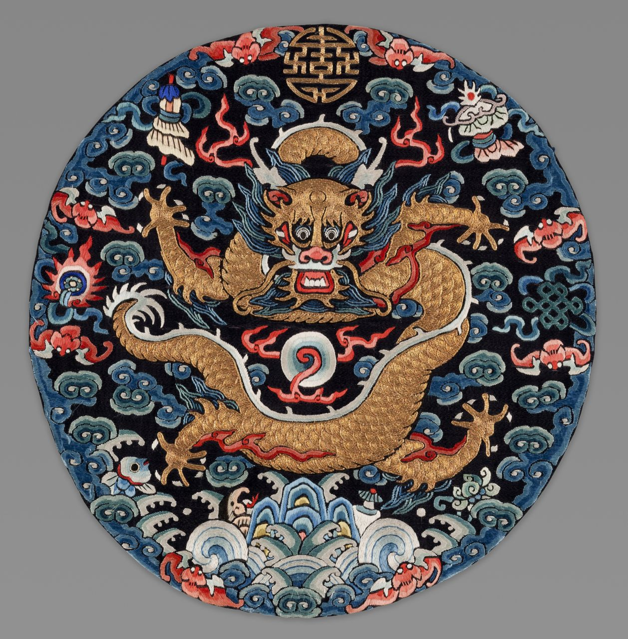 "An imperial dragon insignia designed to be worn on a men's surcoat during the Late Qing Dynasty, circa 1875-1900, is part of ""Threads of Heaven"" (pun intended, we hope!). The exhibition, opening Sunday at the Denver Art Museum, features the spectacular clothing and accessories worn toward the end of China's last empire."