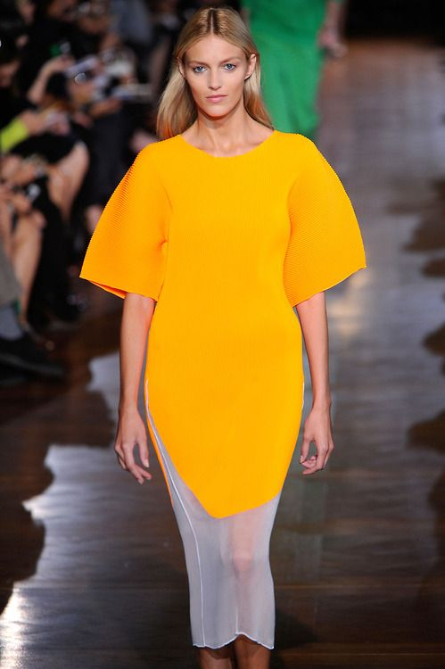 A brilliant shot of yellow in a sporty oversized silhouette from stella mccartney s ss13 show at - Stella mccartney head office ...
