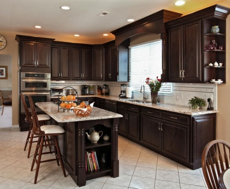 Love this budget kitchen remodel with refaced dark cabinets, Cambria