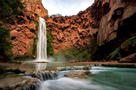 The only better feeling than enjoying the stunning views of the tons of water cascading over the edg... - Thinkstock