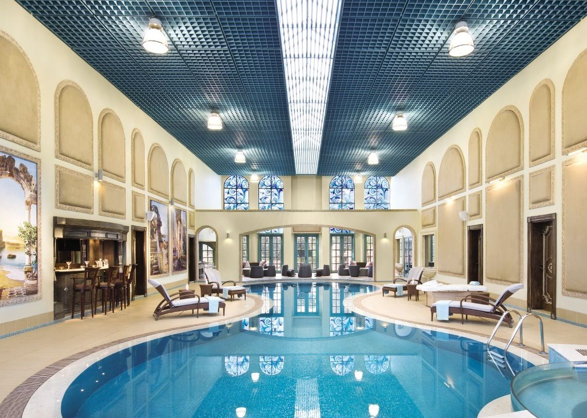 gorgeous indoor pool that features stained glass clerestory