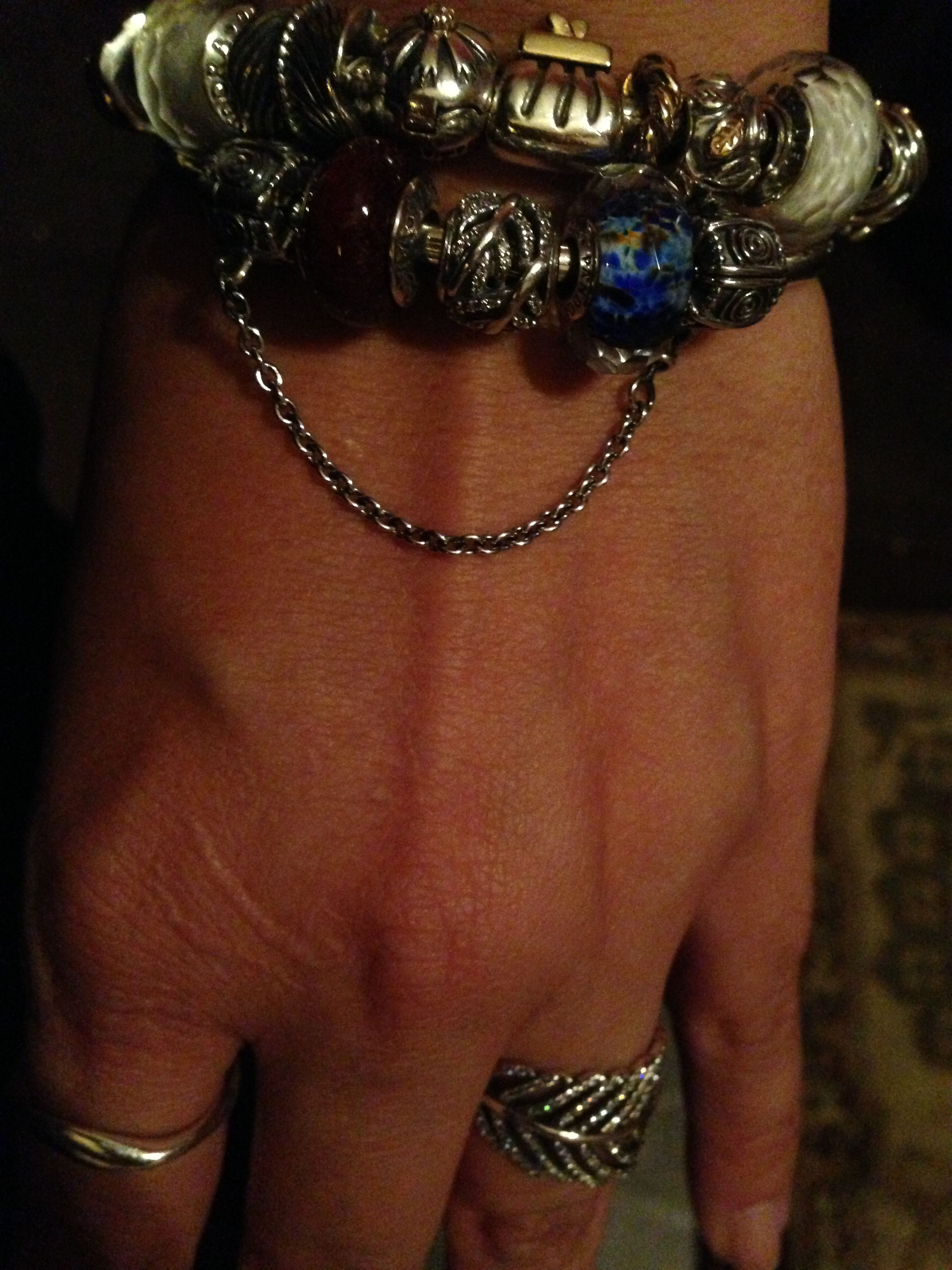 Added a chain to my bangle and I'm loving it! Not to mention my new feather charm and ring :-)