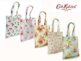 Cath KidstonStrawberry oil cloth book bag.