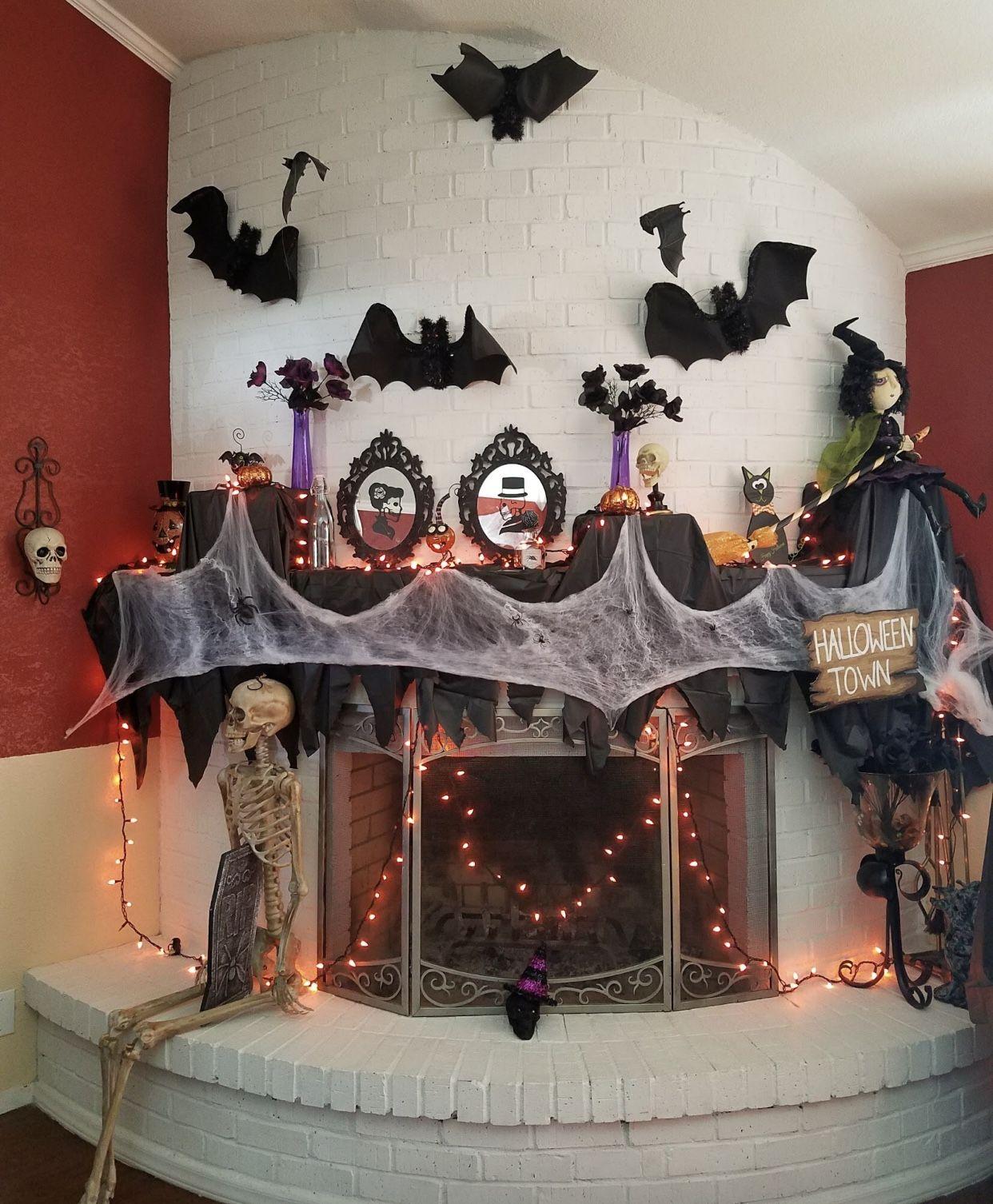 DIY Halloween mantle decorating ideas using black plastic