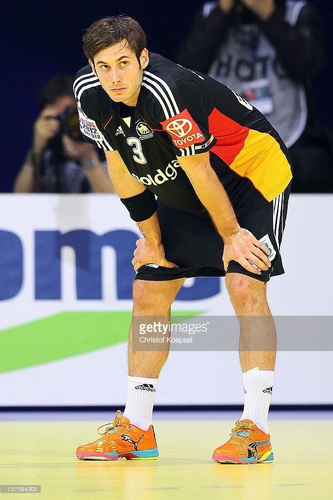 <a gi-track='captionPersonalityLinkClicked' href='/galleries/personality/697757' ng-click='$event.stopPropagation()'>Uwe Gensheimer</a> of Germany looks dejected after the Men's European Handball Championship group B match between Germany and Czech Republic at Cair Sports Centre on January 15, 2011 in Nis, Serbia. The match betwwen Germany and Czech Republic ended 24-27.