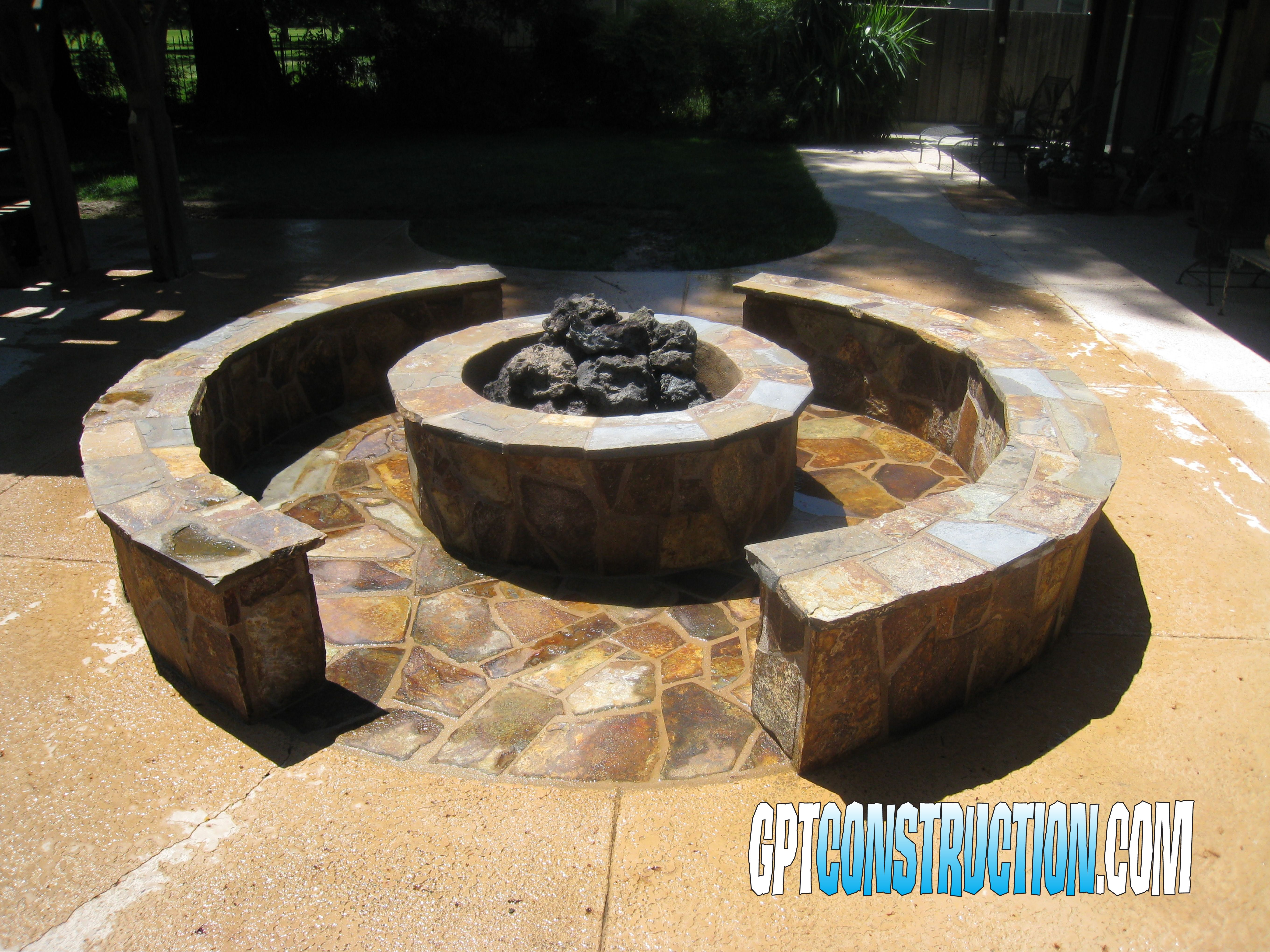 gas wood burning outdoor fire pit adjacent to swimming pool by