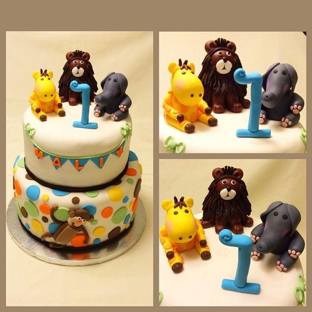 First birthday cake with safari animals httpinstagramcom