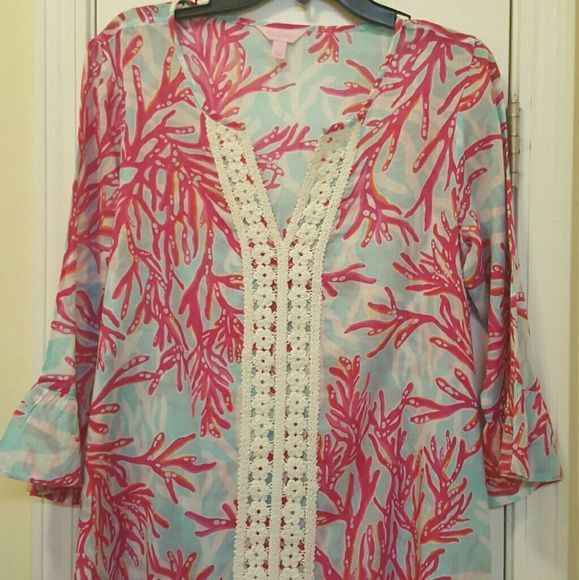Underwater Escape V-Neck Tunic NWOT  Underwater Escape V-Neck Tunic With Lace Details And Flounce Sleeves. Cotton Gauze - Printed (100% Cotton). No low ball offers becsuse Price is firm   Cheaper  with  , Lilly Pulitzer Tops Blouses