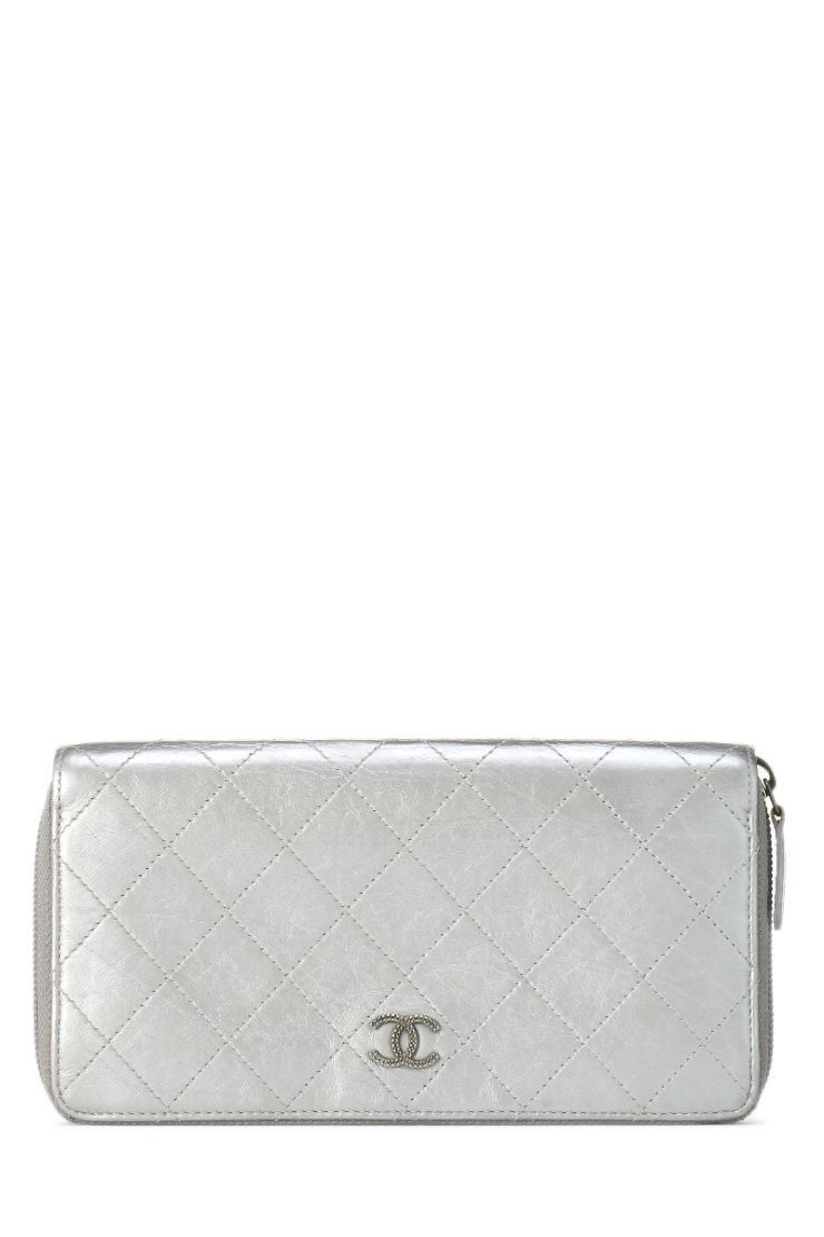 0650c9bcddac3e WHAT GOES AROUND COMES AROUND Silver Lambskin Quilted Continental Zip  Wallet - Chanel. #whatgoesaroundcomesaround #