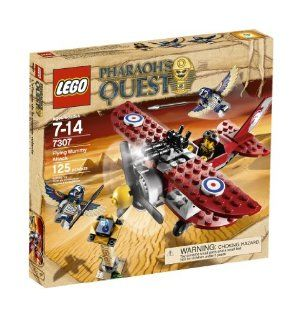 """LEGO Pharaoh's Quest Flying Mummy Attack 7307 by LEGO. $44.64. Plane measures over 6"""" long. Includes Jake Raines and 2 flying mummy figures. Biplane with grab function to grab Soul Diamond from top of obelisk. Pharaoh Amset-Ra?s Soul Diamond rests atop obelisk. 125 elements. From the Manufacturer                Swooping down from the sky in his biplane, Jake Raines uses the plane's grab arm to take one of Pharaoh Amset-Ra's six treasures from the top of the obel..."""
