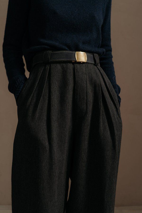 The first pair of pants in our small collection of in house designs. these oversized menswear inspired trousers have a fitted waist double front pleats a single back patch pocket and a slightly cropped fit. shown here in a textured cotton charcoal waffle they are also available in a plain weave olive cotton.    - 100% cotton    - made in los angeles    - model is 5'6