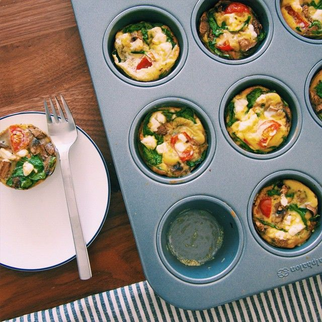 The cutest mini #frittatas I ever did see! These are baked with spinach and heirloom tomatoes, and can be ready in under 30 minutes. Recipe link in bio. #thelazypaleo  #MeatFreeWeek