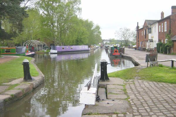 Fradley Junction on the Trent and Mersey Canal, looking south-west from Lock 17. The Coventry Canal leads off to the left.
