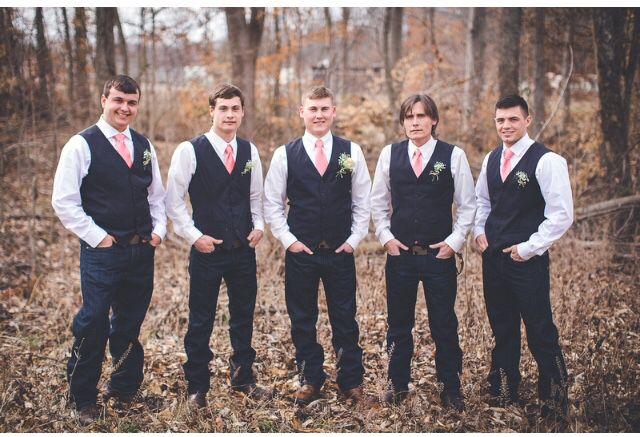 groomsmen in dark levi blue jeans perry ellis vests and tie mart coral ties
