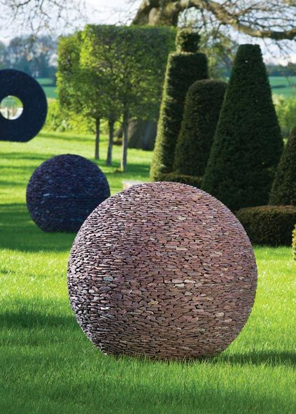Slate Spheres With Slate Torus Sculpture Following A Garden Path