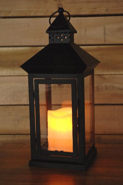 Metal lantern with battery operated candle in