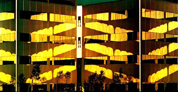 Façade of IBM Santa Teresa buildings with reflective windows.Taken in 1988 with a Nikon FM 35mm camera.