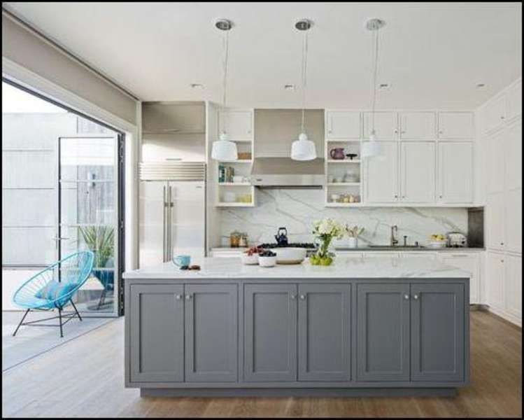 Kitchen With White Cabinets And Grey Island